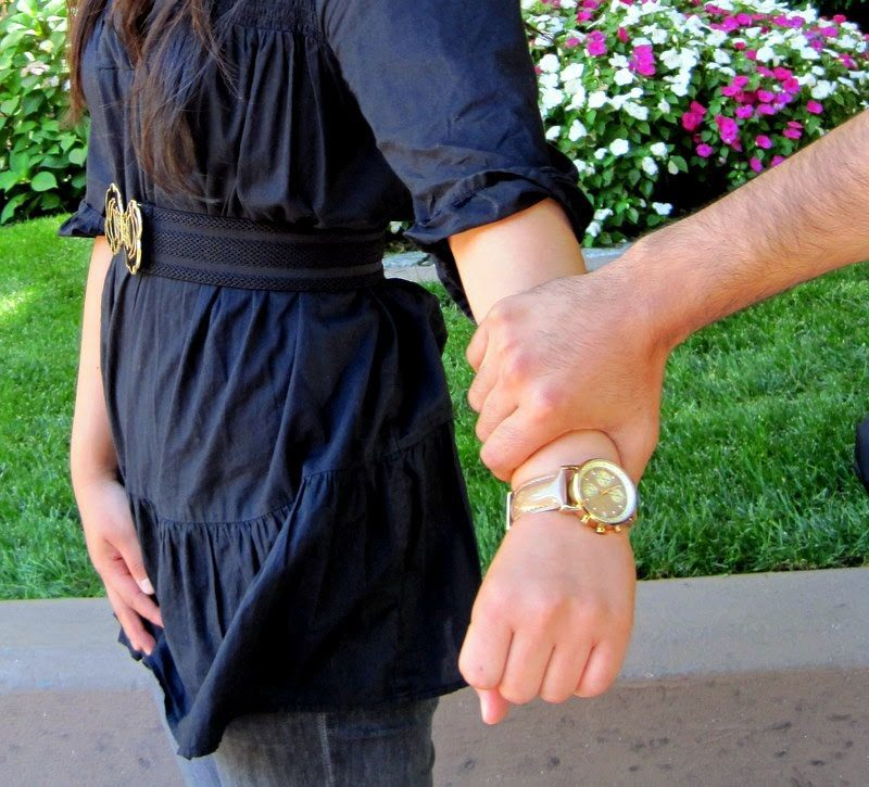 Hand grabbing woman