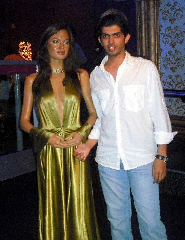 With Angelina Jolie! Can you see Brad's hair behind Faisal?