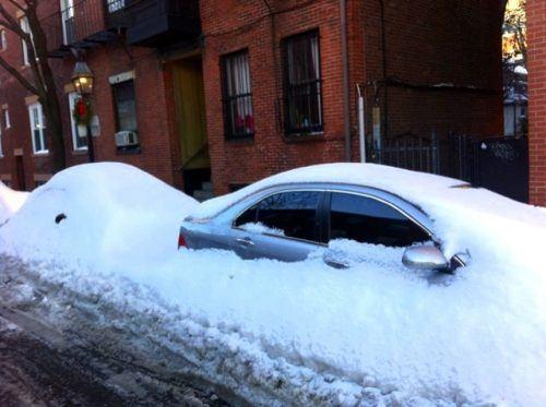 Snow-enveloped cars in Boston.
