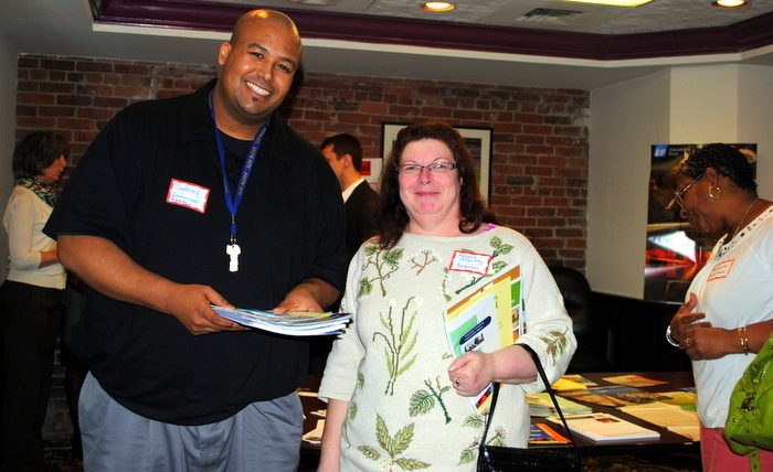Aspiring Teacher-Travelers gather handouts!
