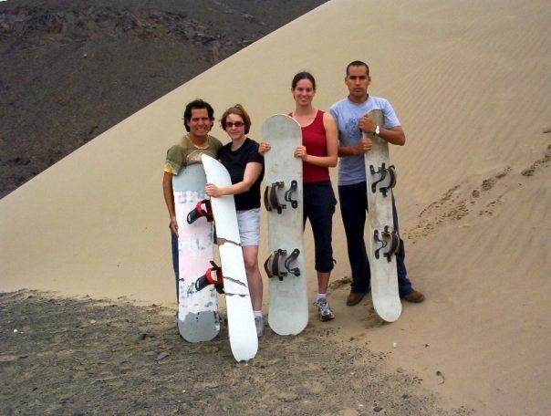Gareth and I prepare to sandboard with our Peruvian brothers.