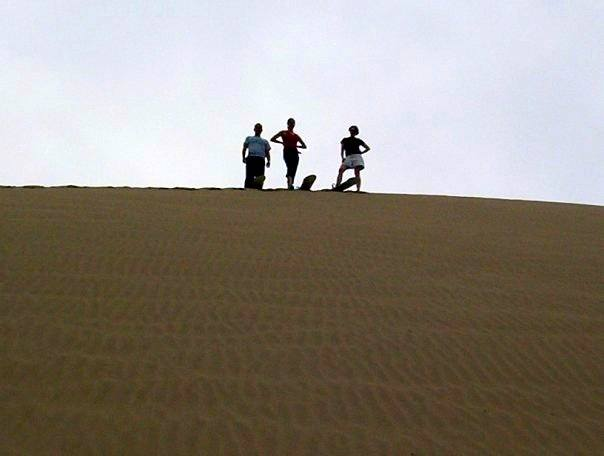 Ready to slide down, high atop the sand dune in Peru!