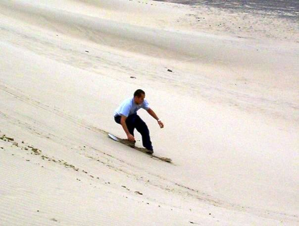 Our host brother, showing how to actually sandboard.