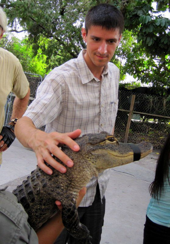 Colin carefully petting a baby alligator in the Everglades.