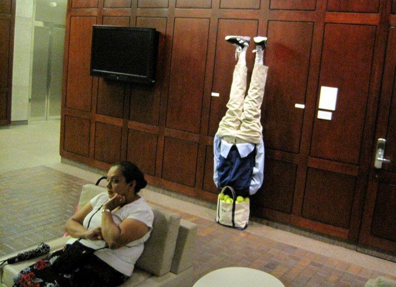 Upside down person public art statue