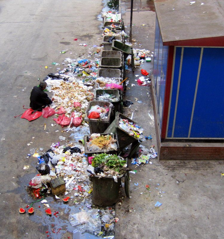 Trash bins below a fancy restaurant in Chongqing.