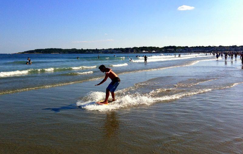 Sliding along the surf at Narragansett Beach, Rhode Island.