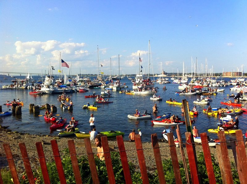 Boats lined the water outside the Newport Folk Festival to listen.