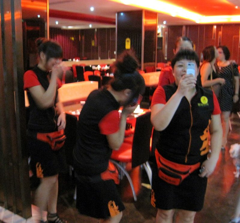 Waitresses giggling and photographing us in Yunyang.