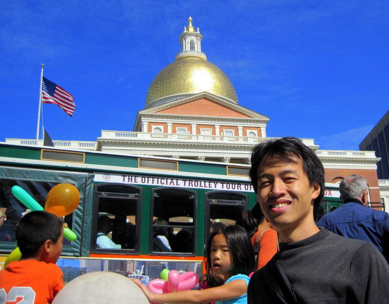 My friend Angel in front of the State House and tour bus.