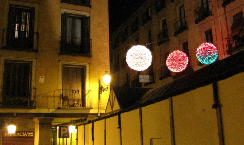 Glowing balls of light hang through the centuries-old streets of Madrid.