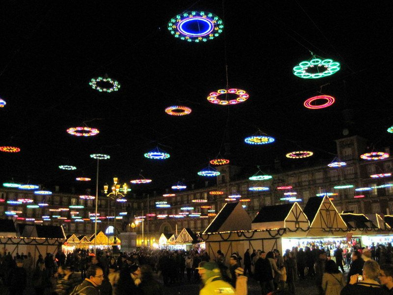 The lights in the Plaza Mayor look like benevolent UFOs above the gift stalls!