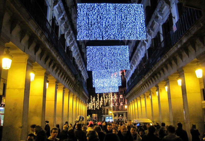 Spain's historic, packed streets are gilded with lights!