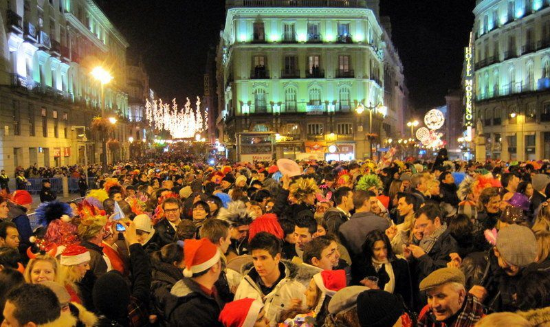 Thousands celebrate the New Year at Madrid's Puerta del Sol, the