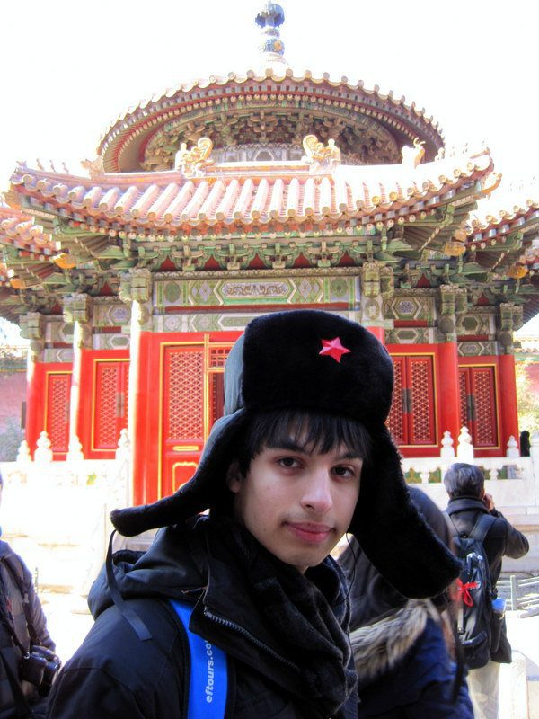 Julio in the Forbidden City, wearing a bargained hat.