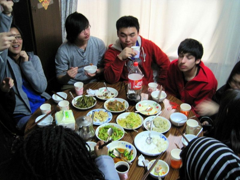 Eating a cozy dinner in a small Hutong house with friends.