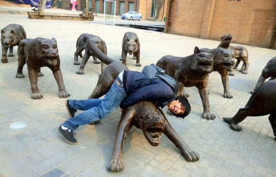Another Boston student frolicking with the bizarre Art Zone sculptures.