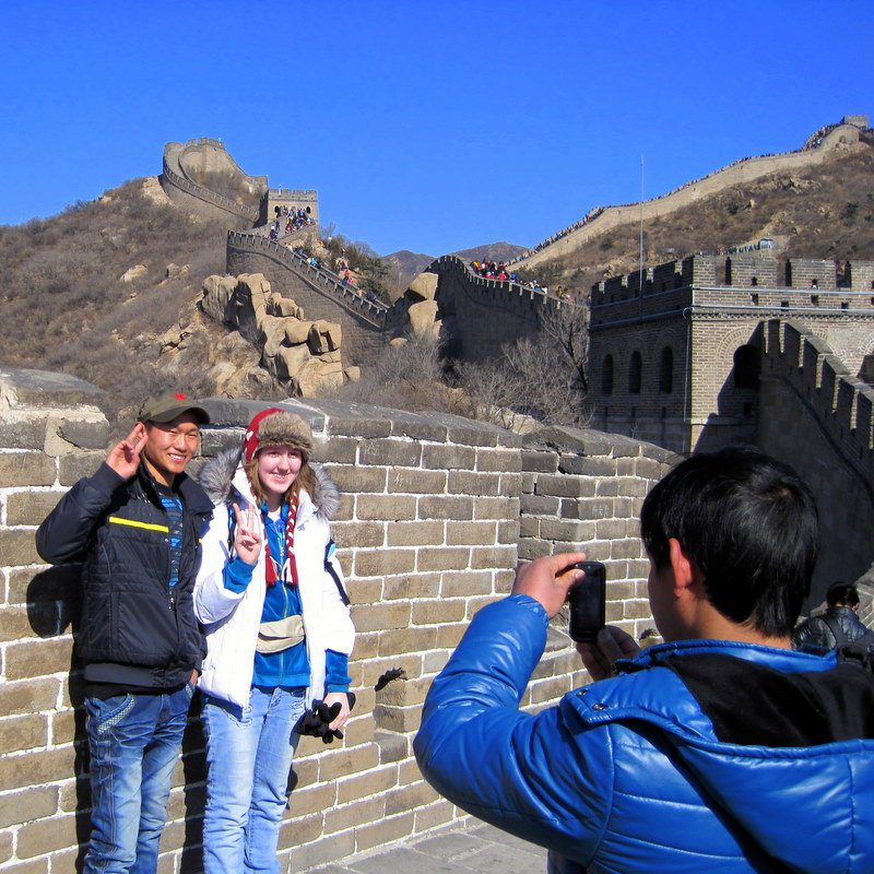 Strangers taking photos with Celebrity Candace at the Great Wall!