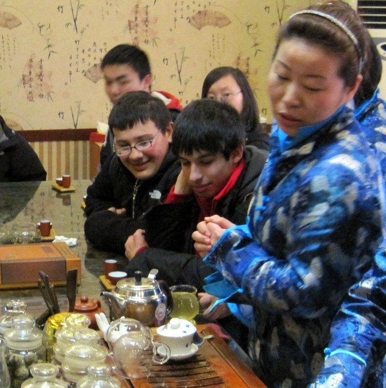 Watching intently at a tea ceremony in Beijing.