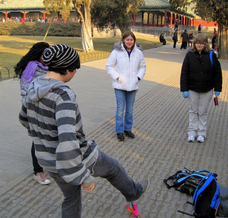 "Playing ""Chinese Hacky Sack"" in Tiantan Park. He missed it!"