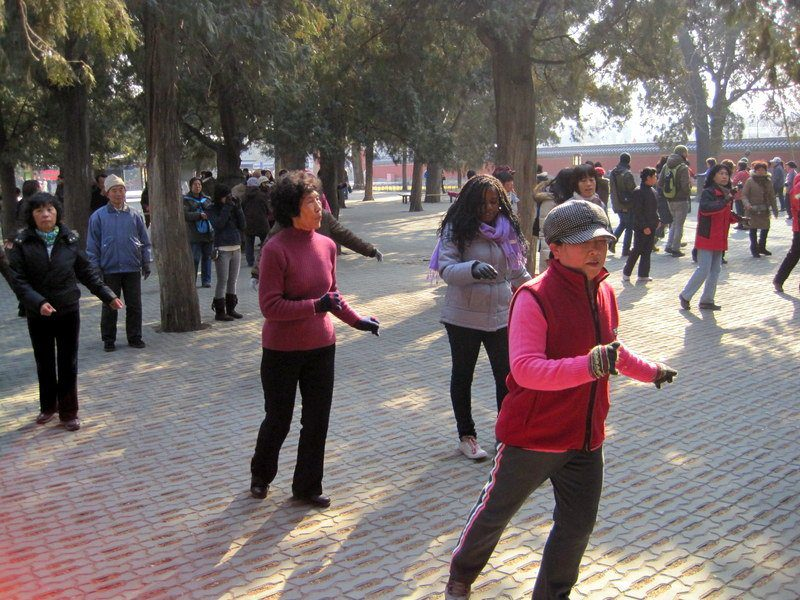 LOVE this photo of Stephane dancing to Britney Spears with locals during their daily exercise in Tiantan Park.