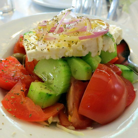 Greek Salad: Feta, tomato, cucumber, onion, and olive oil.