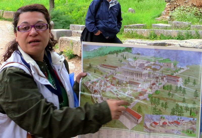 Our guide, Mara, shows what Delphi looked like at its height.