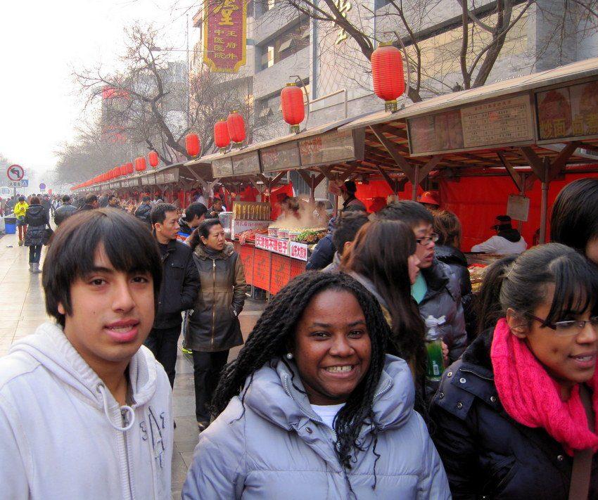 Daniel and a Boston classmate at Beijing's Night Market.
