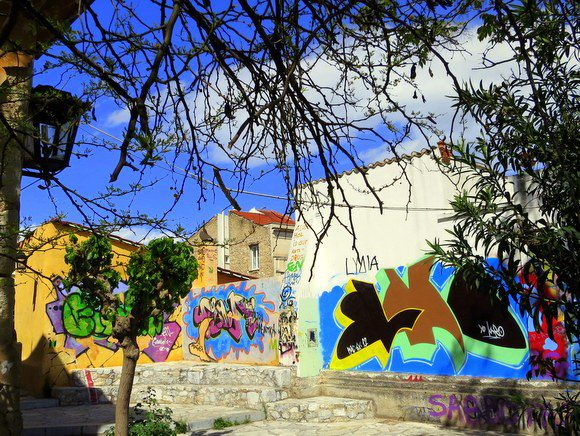 Graffiti slathers the walls of Greece, like on this Athens building.