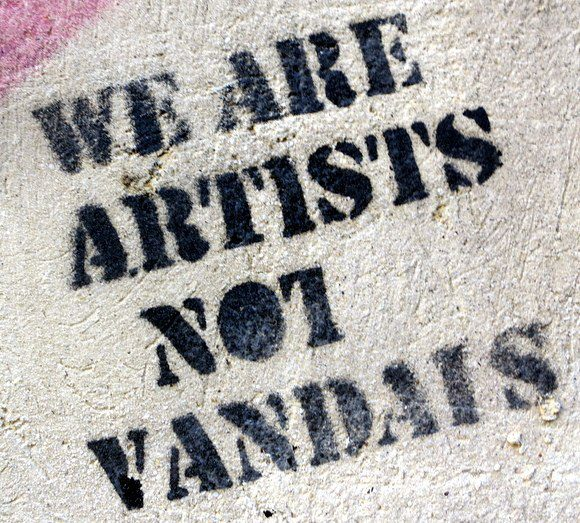 Graffiti in Nafplio, Greece, about how graffiti is actually art, not vandalism.