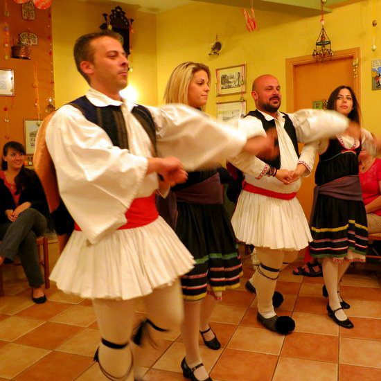 Traditional Greek dancing with traditional fluffy white Man Skirts.