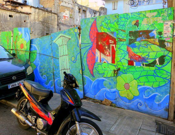 Is this pretty wall in Athens the result of paying graffiti artists to do legal public art?