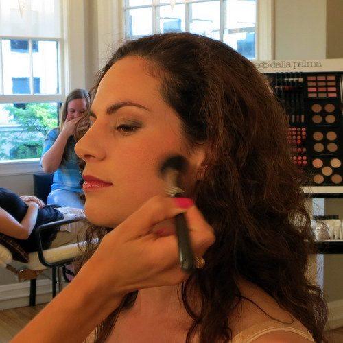 Adding blush to contour my cheekbone region.