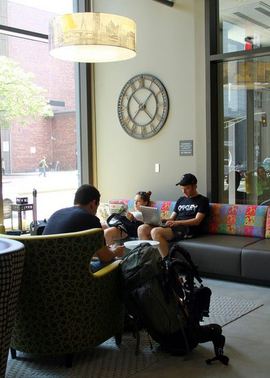Happy travelers relaxing in the Boston hostel lobby.