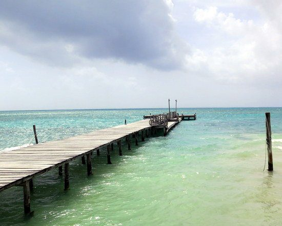 Tiny Caye Caulker, Belize has many piers like this into the Caribbean.