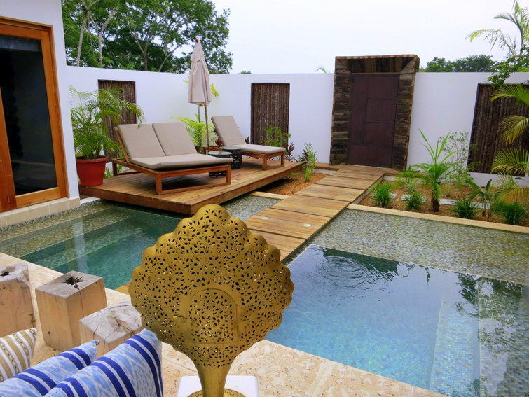 The view from the Two Bedroom Private Pool Villa, looking out at the metal door to the luxurious compound. When you rent this villa, you get your own designated staff person!