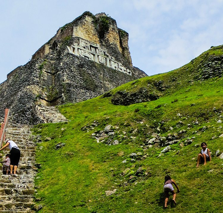 The sides of Xunantunich are adorned with ornate, highly symbolic decorations. When we visited, these girls were sliding down the hill!