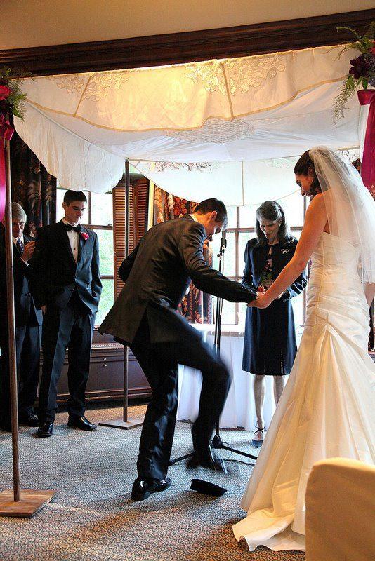 The groom breaks a glass!