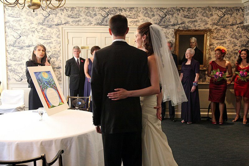 Admiring the ornate Ketubah as the Cantor tells the story behind it.