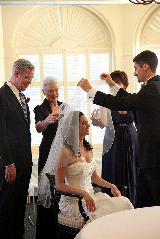 In the Bedekken ceremony, the groom puts the veil over his bride.