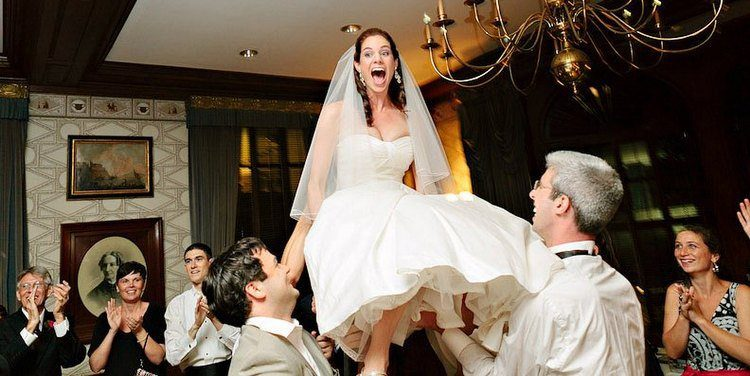 An awesome Jewish wedding tradition: The Bride and Groom are lifted on chairs during the Horah dance!