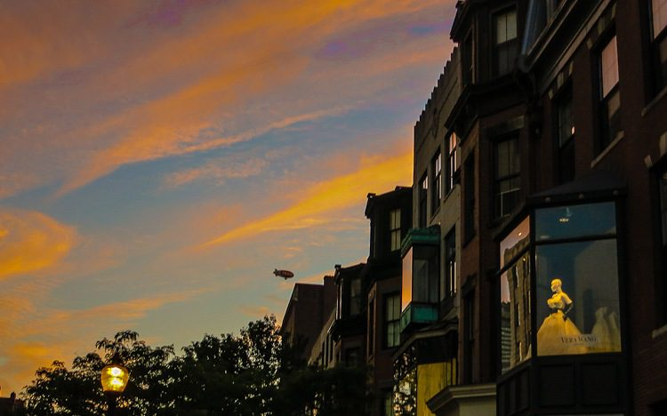 Sunset Boston: The wedding dress woman of plastic is eyeing the blimp warily.