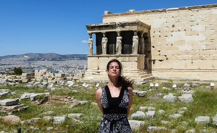 With the famous statues at the Acropolis, mimicking their serious expressions.