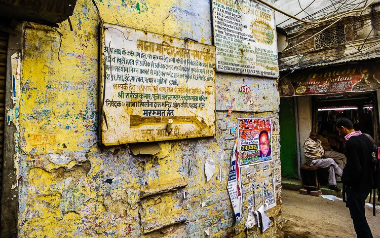 Tattered posters on the walls in Paharganj, New Delhi make art.