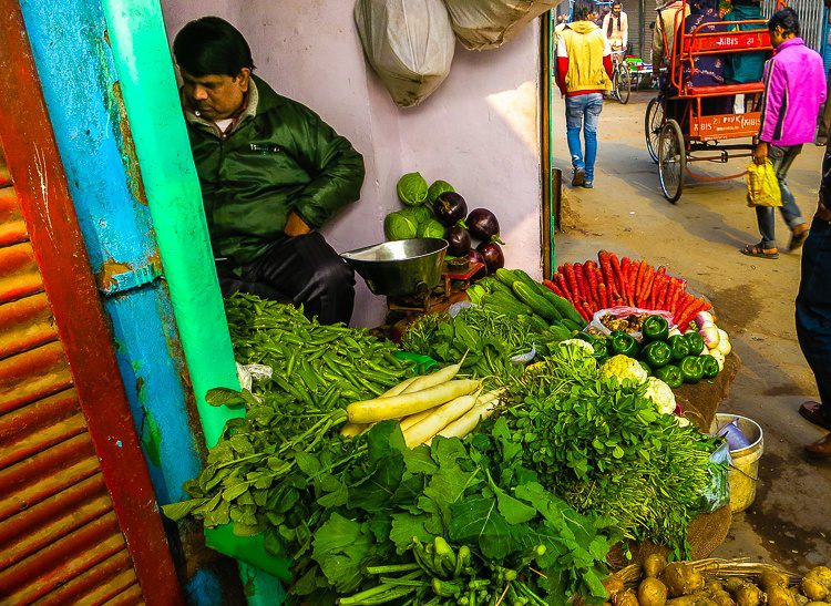 Does this vendor's jacket make him look like one of his green peppers?