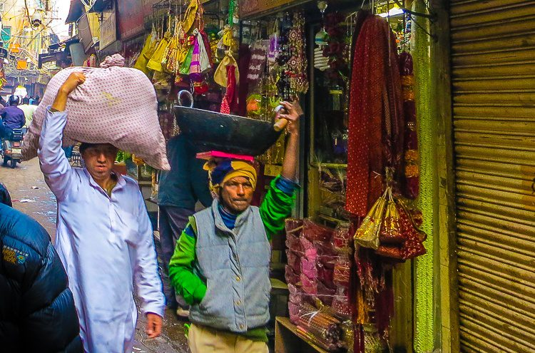 So many ways to carry goods in Old Delhi...