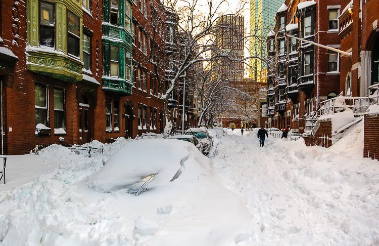 Blizzard snow smothered Boston's streets and parked cars. Can you see the hood peeking out?