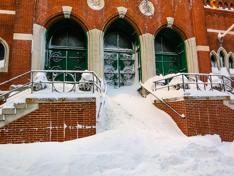Church stairs in Boston completely covered in snow