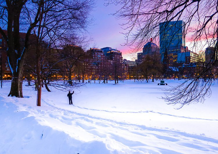Boston Public Garden under snow at sunset