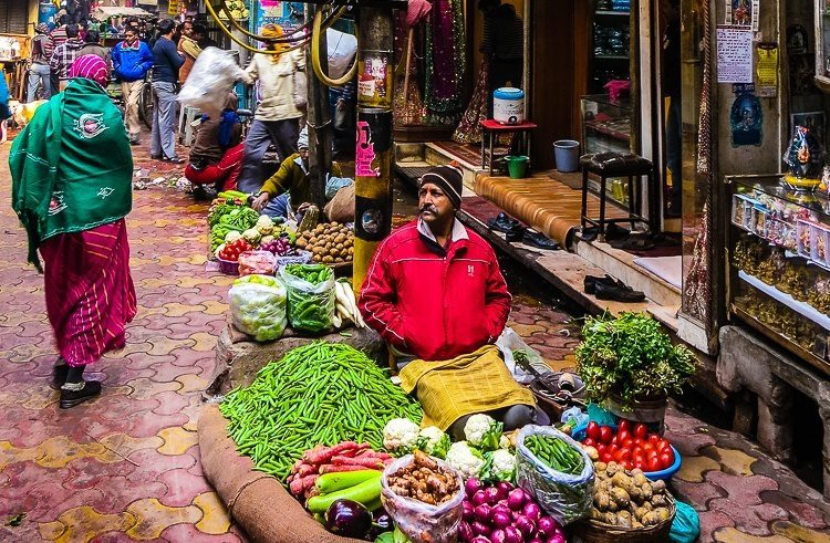 A produce vendor in Old Delhi taking in the sights...